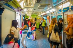 SINGAPORE, SINGAPORE - JANUARY 30, 2018: Unidentified people inside of a tran at Mass Rapid Transit MRT train through. The city centre Stock Photography