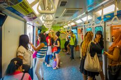 SINGAPORE, SINGAPORE - JANUARY 30, 2018: Unidentified people inside of a tran at Mass Rapid Transit MRT train through. The city centre Royalty Free Stock Photo