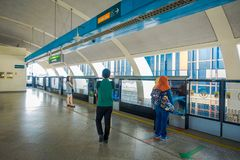 SINGAPORE, SINGAPORE - JANUARY 30, 2018: Unidentified people waiting for the train, Mass Rapid Transit MRT train through. The city centre. Opened in 1987 the Stock Photos