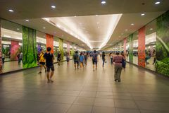 SINGAPORE, SINGAPORE - JANUARY 30, 2018: Unidentified people walking at Interior of Marina Bay Sands Shopping Mall in. Singapore. Singapore is a global Royalty Free Stock Photo