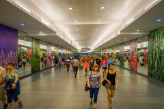 SINGAPORE, SINGAPORE - JANUARY 30, 2018: Unidentified people walking at Interior of Marina Bay Sands Shopping Mall in. Singapore. Singapore is a global Royalty Free Stock Image