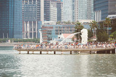 SINGAPORE - JUL 17: The Merlion fountain and Singapore City on J Stock Photo