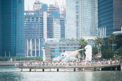 SINGAPORE - JUL 17: The Merlion fountain and Singapore City on J Royalty Free Stock Image