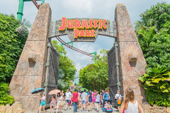 SINGAPORE - JULI 20: Jurassic Park tema i si för universella studior Royaltyfri Bild