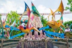 SINGAPORE - JULI 20: Jurassic Park tema i si för universella studior Arkivfoto