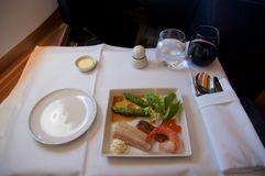SINGAPORE - JULY 22, 2016: Business Class meal in the Airbus A350 Stock Image