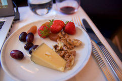 SINGAPORE - JULY 22, 2016: delicious chese and fruits selection in Business Class in the Airbus A350 royalty free stock photos