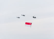 Singapore July, 18 2015: helicopter fly on sky for Fiftieth ann stock photo