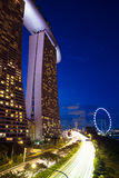 Singapore - July 9: Marina Bay Sands Hotel and Singapore Flyer, 9 July 2013. Stock Images