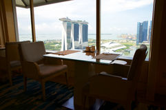 SINGAPORE - JULY 23rd, 2016: inside of a lounge at 5 star luxury hotel the Marina Bay, great view and comfortable sofa. Or chair Royalty Free Stock Images