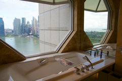 SINGAPORE - JULY 23rd, 2016: luxury Hotel room with modern interior, beautiful Large bathroom marble. SINGAPORE - JULY 23rd, 2016: luxury Hotel room with modern Stock Photos