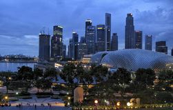 SINGAPORE - JULY 2007: Singapore skyline at sunset and cloudy sky. Royalty Free Stock Images