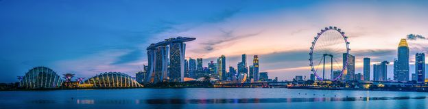 SINGAPORE - JULY 9, 2016 : Singapore Skyline and view of skyscrapers on Marina Bay at twilight time. stock image