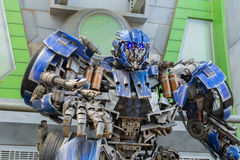 SINGAPORE - JULY 20 ,2015 : TRANSFORMERS The Ride: The Ultimate. 3D Battle The statue of Autobot robot at Sci-Fi City, Universal Studio, Singapore Stock Photos