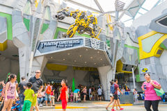 SINGAPORE - JULY 20,2015 : TRANSFORMERS The Ride: The Ultimate 3. D Battle The statue of Autobot robot at Sci-Fi City, Universal Studio, Singapore Stock Image