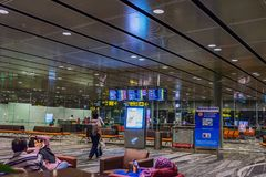 Visitors walk around Departure Hall in Changi Airport Singapore Royalty Free Stock Images