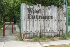 Wood wall entrance sign. Singapore - july 15, 2018: West Entrance sign on wood wall royalty free stock images