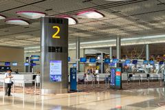 Visitors walk around Departure Hall in Changi Airport Singapore royalty free stock photos