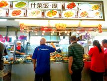 Singapore Locals buying cook food Royalty Free Stock Photos