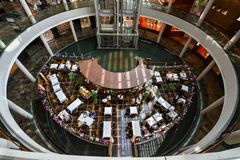 Aerial view of diners enjoying a meal at a restaurant at The Shoppes at Marina Bay Sands. SINGAPORE - MARCH 10, 2016: aerial view of diners enjoying a meal at a Stock Photo