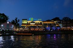 SINGAPORE - March 7, 2019 : Colorful light building at night in Clarke Quay, Singapore. Clarke Quay, is a historical riverside qua. SINGAPORE - March 7, 2019 stock image