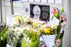 SINGAPORE - MARCH 23:A flower and wall tribute to the late ex prime minister of Singapore, Mr Lee Kuan Yew who died. Stock Photos