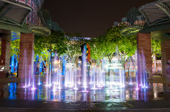 SINGAPORE - March 19, 2016 : fountain on floor at night in Sento. SINGAPORE - March 19, 2016 : fountain on floor at night with merlion behind in Sentosa island Royalty Free Stock Image