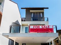 SINGAPORE, 15 MARCH 2019 - Low angle view front view of a house for sale with red royalty free stock photo
