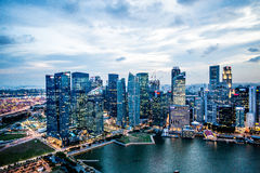 Singapore Marina Bay Financial Center. A photo of Singapore Marina Bay Financial Center taken at dusk Stock Photo