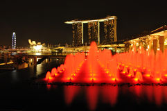 Singapore Marina Bay and fountain. At night Royalty Free Stock Photos