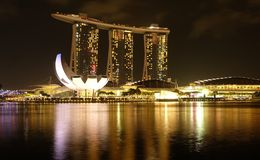 Singapore Marina Bay night view in golden colours. Night view over Singapore Marina Bay with their famous landmarks, in golden colours Stock Photography