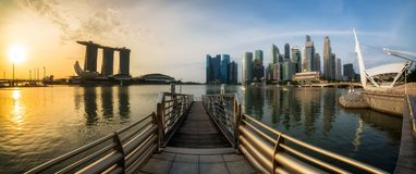 Singapore Marina Bay in Panoramic View at Sunrise. Singapore Marina Bay in Panoramic View at Waterfront Harbor. Panorama Image of Singapore Landmark Cityscape Stock Photos