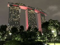 Singapore marina bay sands most famous hotel in city. View at night with pink color Stock Photography