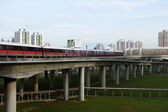 Singapore mass rapid train MRT travels on the track in Jurong. SINGAPORE - JAN 15, 2016: Singapore mass rapid train MRT travels on the track in Jurong East Royalty Free Stock Photography