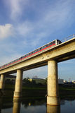 Singapore mass rapid train (MRT) travels on the track Stock Photography