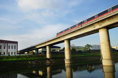 Singapore mass rapid train (MRT) travels on the track Stock Image