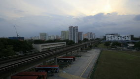 Singapore Mass Rapid Transit in Eunos District at Sunset with Moving Clouds Timelapse Stock Image