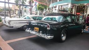 Singapore - May 25, 2019: Old vintage retro classic black car parked on the street. Back side view stock images