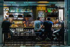 SINGAPORE-MAY 24 2017: outdoor Bar counter night scene. SINGAPORE-MAY 24 2017: outdoor Bar counter night stock image
