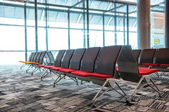 SINGAPORE - May 06, 2016: Seats inside airport terminal Royalty Free Stock Image