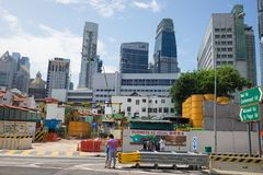 Singapore - May 2, 2016: Singapore cityscape with under construction site on Maxwell Rd, Singapore.  Stock Photos