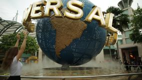 Sentosa Universal Studios. Singapore - May 2, 2018: tourist women visiting the Hollywood movie theme park in Sentosa island and posing with Universal Studios stock video footage