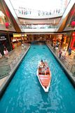 Singapore : MBS. Tourist and locals taking a sampan ride (boat ride) at the canal within MBS Royalty Free Stock Image
