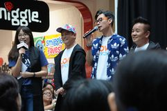 Singapore mediacorp celebrities. Singapore Love 97.2FM music station deejays on stage at Jurong Point shopping mall. From left - Bukoh Mary, Dennis Chen, Mark stock photography