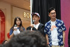 Singapore mediacorp celebrities. Singapore Love 97.2FM music station deejays on stage at Jurong Point shopping mall. From left to right - Bukoh Mary, Dennis Chew royalty free stock photography