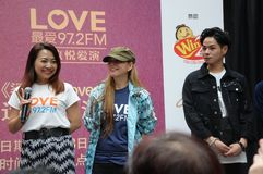 Singapore mediacorp celebrities. Singapore Love 97.2FM music station deejays on stage at Jurong Point shopping mall. From left - Violet Fenying and Lina Tan stock image