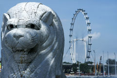 Singapore city merlion and flyer. Modern architecture and landmarks of singapore city state the merlion and the flyer observation wheel Stock Images
