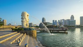 Singapore Merlion Park time lapse with sunrise in Singapore. Singapore city, Singapore - April 9, 2018: Singapore Merlion Park time lapse with sunrise in stock video footage