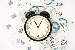 Singapore money and clock. On white  background Royalty Free Stock Photography