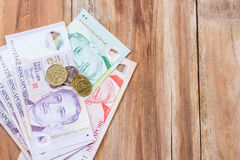 Singapore money on wooden table background Royalty Free Stock Photo